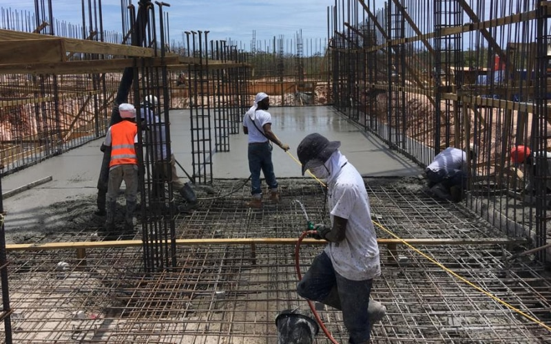 Anguilla builders pouring concrete in foundation with steel reinforcement