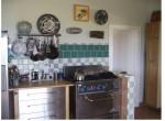 Kitchen range looking to pantry